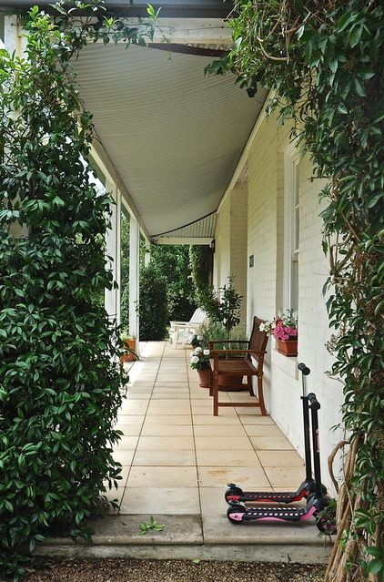 porch entrance with vines eclectic patio by Luci.D Interiors
