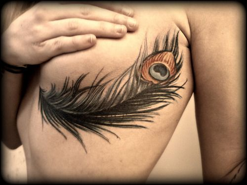 under breast tattoo   edit: Okay, I actually found a picture of someone with a peacock ...