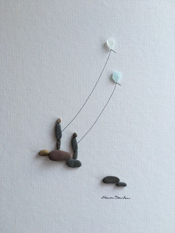 Kite flying pebble art with sea glass kites by sharon nowlan