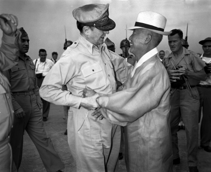 General Douglas MacArthur and Syngman Rhee, Korea's first President, warmly greet one another upon