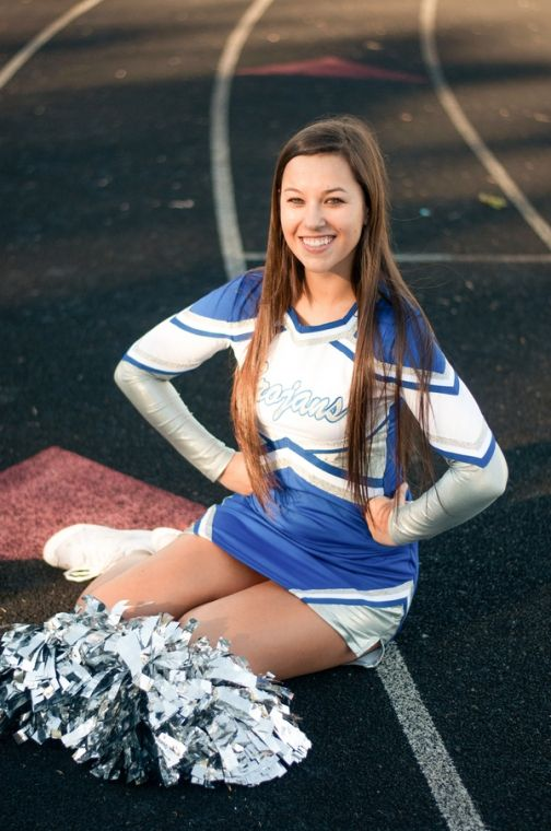 High School Cheerleader Poses In Uniform With Silver Pom Poms by Amber Lane Photography | Two Bright Lights :: Blog