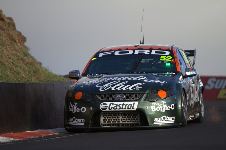 The David Reynolds / Dean Canto retro Bottle-O Ford Falcon coming into The Dipper during Bathurst 1000 warm up. This was definitely my favourite livery of the event, made even more special with the fact the signage was hand painted. Oh, and who said V8 Supercars didn't shoot flames any more?    Photo by Craig Coomans ©. Feel free to share, simple ensure you credit the photo to me.