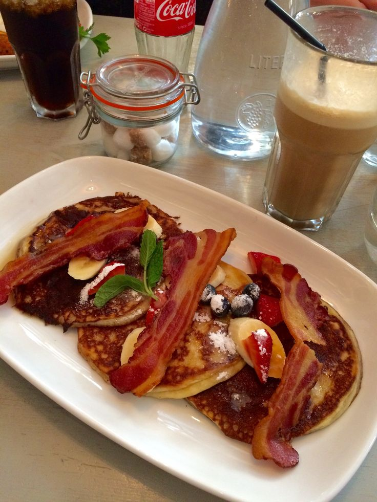 Blueberry pancakes with strawberries, blueberries, maple syrup and bacon at Bill's, Baker Street, London.