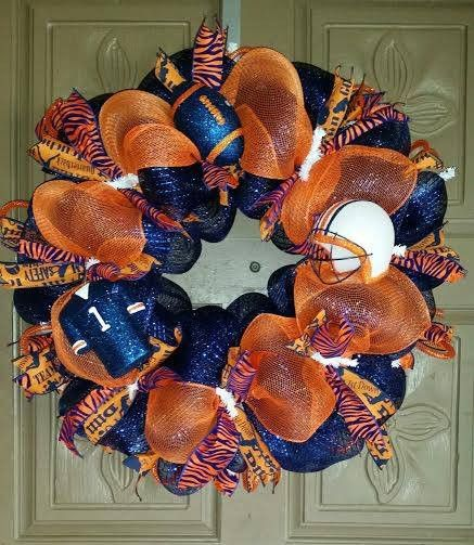 """This is a 24"""" hand crafted Auburn Tigers deco mesh wreath made with orange and navy blue mesh and matching orange and blue """"tiger"""" ribbons. It is also accented with Auburn football style ornaments. AL"""