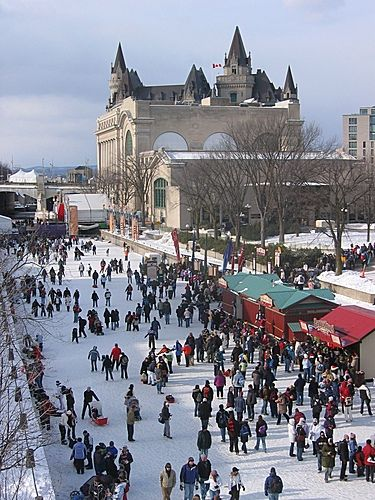 Skaters on Rideau Canal from Mackenzie King Bridge, Ottawa, Ontario. * I want to eat a Beaver Tail! :)