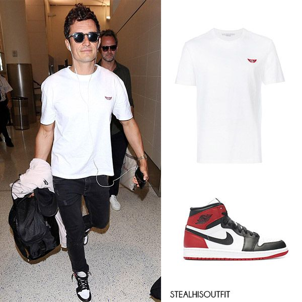 Orlando Bloom travel style. White t-shirt and high top leather Nike sneakers