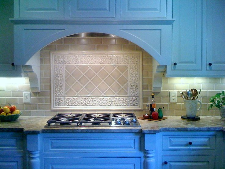 Beautiful Light Beige Colored Kitchen Backsplash Next To Bright Blue  Cabinets. Tile Shown Is 4x4