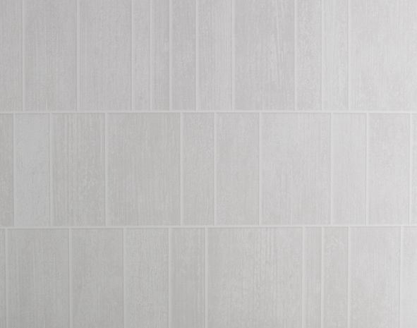 """Le revêtement Element vous propose une alternative séduisante au carrelage mural, idéale pour la salle de bain. Bluffant de réalisme avec ses matières béton aux tonalités actuelles et la profondeur de ses jeux d'ombrage, Element est 100% étanche, même quand il est soumis aux projections de la douche. Résolument déco, les coloris Element se déclinent en plusieurs motifs coordonnables qui vous permettent de varier les murs ou de créer une rupture façon """"frise""""."""