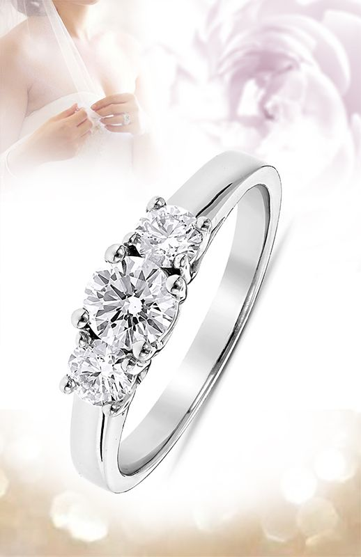 This Platinum Diamond Three Stones Engagement Ring showcases a 0.50 carat round diamond in the center and 0.50 carat of round diamonds on the sides for a total of 1 carat of dazzling diamonds and is available in Platinum, 18k or 14k yellow, rose, white gold, various sizes, and can be customized with any color and quality diamonds.