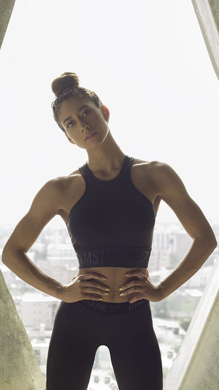 Get Gymshark athlete Karina Elle's workout hairstyle look.  Comb your hair up smoothly into a high pony. Wrap your hair around to create a high bun and secure.