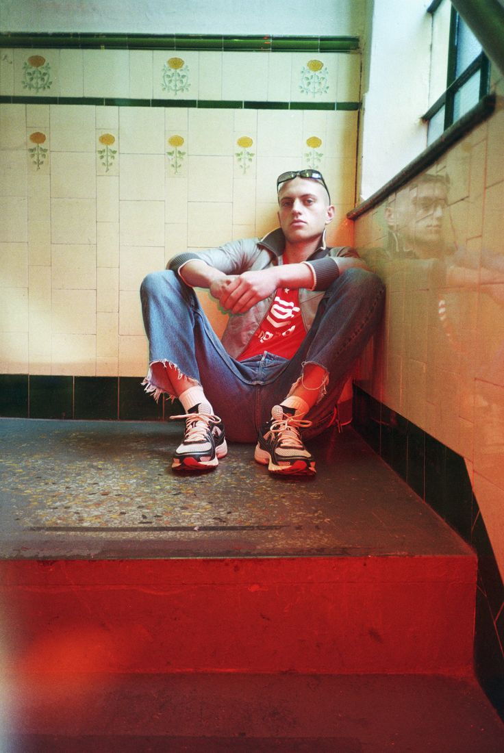 In The Red - Teeth Online x Teeth Magazine  Photographer: Nina Parsons Stylist: Anne Lauritzen Hair: Stefan Bertin using Bumble and Bumble Makeup: Coco Hirani using MAC Cosmetics Model: Lucas Sides at Unsigned Group  Jacket: HAAL, T-Shirt: UMBRO, Denim: Levi's, Trainers: Nike at Blitz London, Sunglasses: TK Maxx