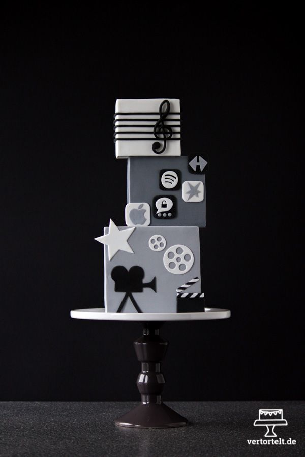 A square cake - simple without any colours - A cake about music, movie and mobile phone