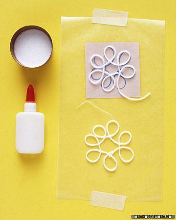 Snowflake ornaments. Yarn, glue, and wax paper.