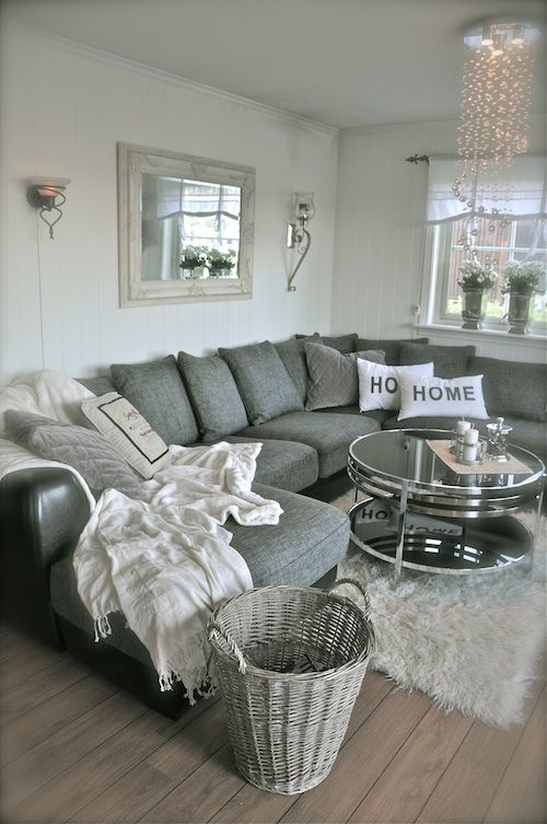 Great U-Shape sectional in grey and chrome and glass coffee table.