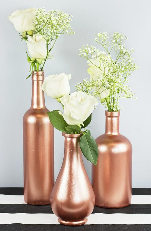 Rose Gold Wine Bottle Decor - Dress a table with fresh flowers and rose gold bottles. #decoartprojects