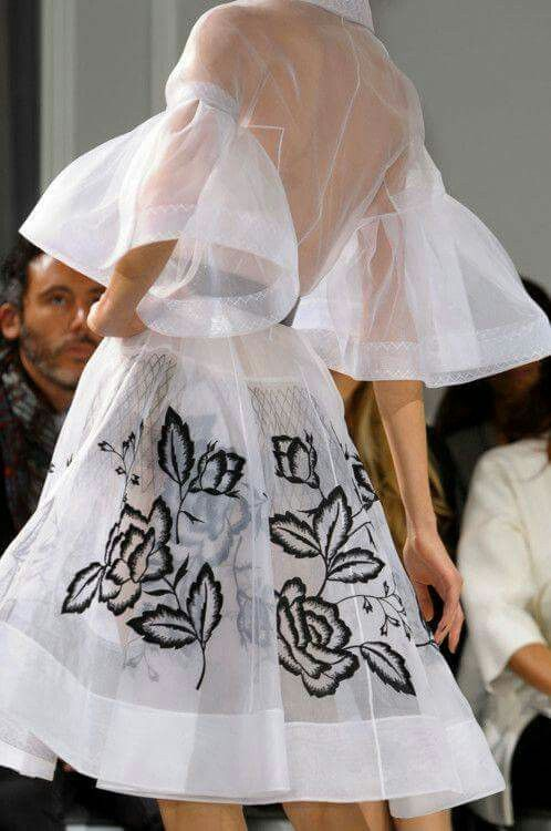 Sheer white dress with black embroidered flowers