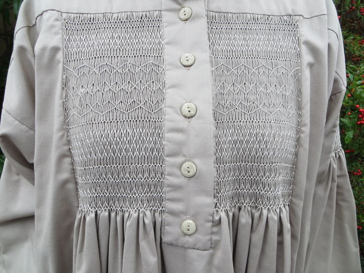 Smocking on a traditional smock, repeated on the back and sleeves, hours of work, but very happy with the result. This will shortly  be offered for sale on my website, http://www.fleecehatsbyjacaranda.co.uk/