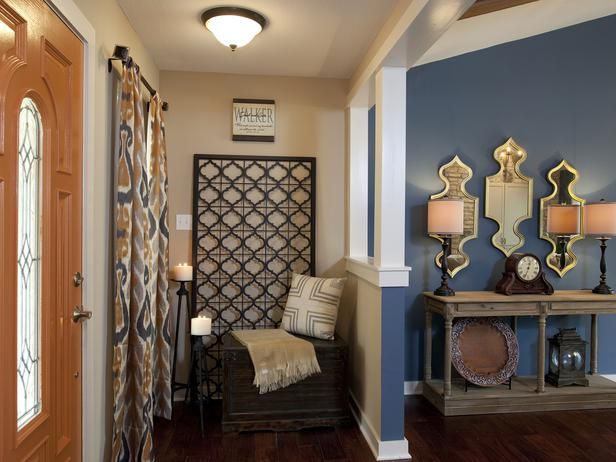 Love the grate and candle holders. Custom-made window treatments and rustic accessories create a warm entry area off the living room, as seen on HGTV's Property Brothers.