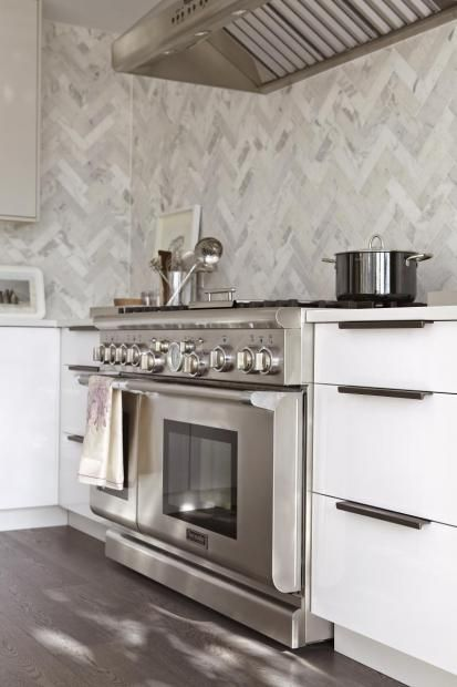 Very, very nice.   Herringbone marble tiles and streamlined hardware- a great blend of traditional and modern in this kitchen.