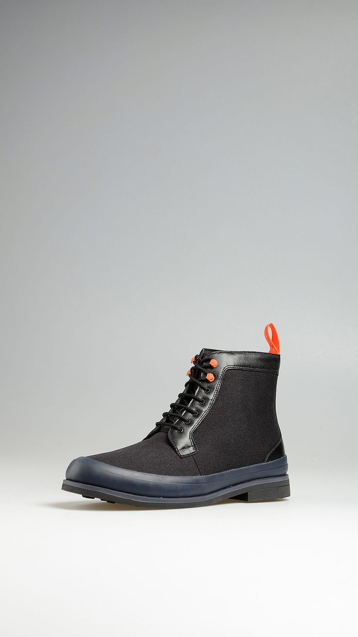 Swims canvas ankle boots with contrast leather details and contrast sole, leather and rubber lining, rubber sole, 0.9 inch. - 2,5 cm heel, 0.3 inch - 1 cm platform.