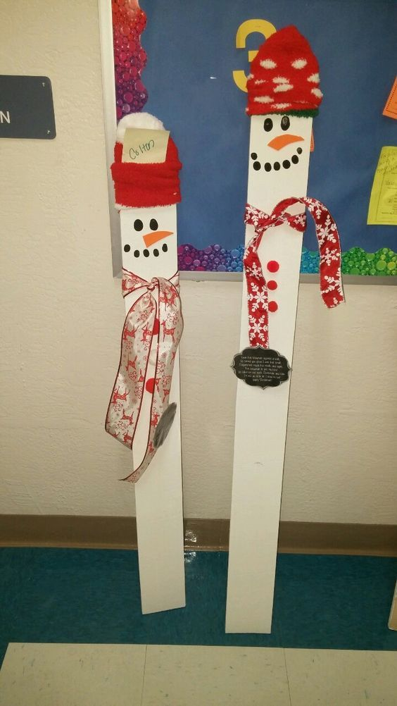 Snowman on a wooden board measuring kids height eyes and mouth are made from fingerprints socks for hats!