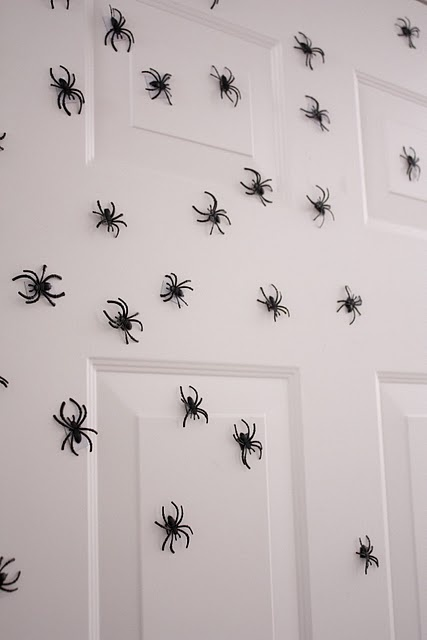Spiders crawling all over the door...done with dollar store spider rings & magnets.