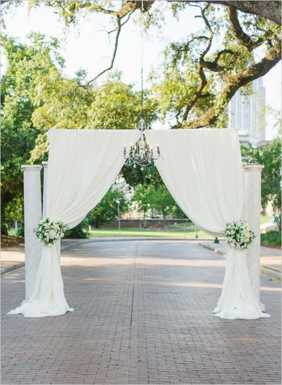 Ceremony Location Created With Pipe Amp Drape Suspended Chandelier And Columns