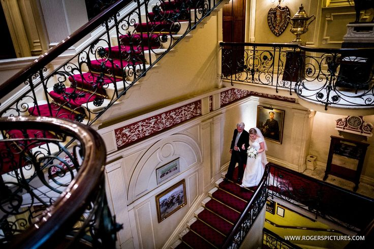 Proud Dad walks Natalie down the stairs at the Cavalry and Guards Club before this Kensington Palace wedding -
