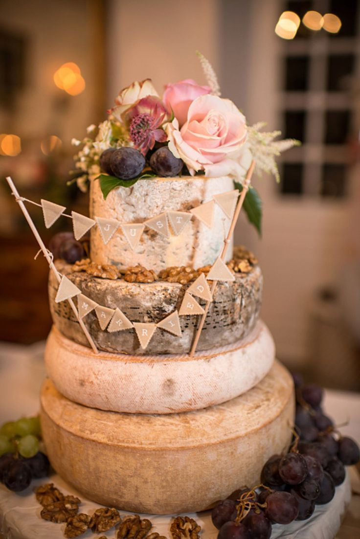 Cheese tower decorated with fresh flowers and fruit | Photography by http://louiseadbyphoto.com/