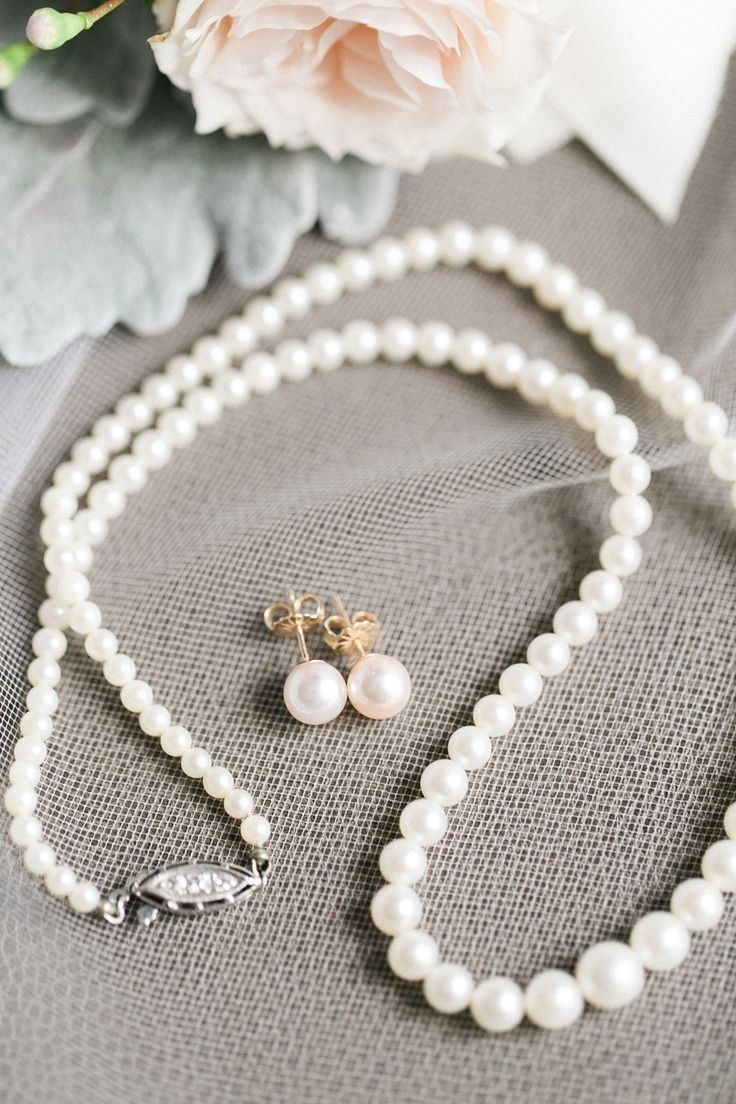 Pearls -- the perfect wedding accessory. Read More of this bride's story on SMP: http://www.StyleMePretty.com/2016/05/21/one-pearl-necklace-three-generations-the-perfect-bridal-accessory/ Sweetlife Photography