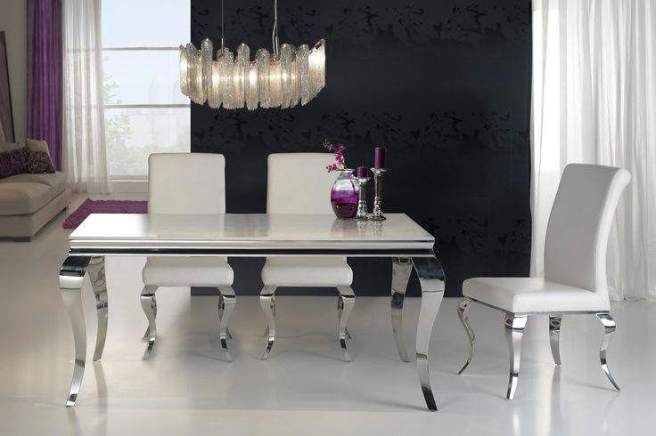 Modern Louis glass top dining table. This rectangular dining table is finished with a tempered white glass top and polished edge and has elegant curved legs made from stainless steel.
