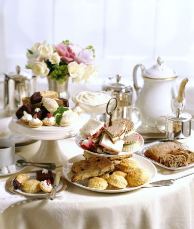 """Afternoon Tea vs. High Tea: The drinking of tea not only became a social event for the upper classes, but also a bridge between meals, a """"mini supper"""" in itself. However,  the working classes ran to different schedule and budget. Tea was still expensive at the time and the working classes could not afford to waste money on anything other than necessities. Thus, in the industrial areas of the UK, the working class's evening meal evolved: High Tea."""