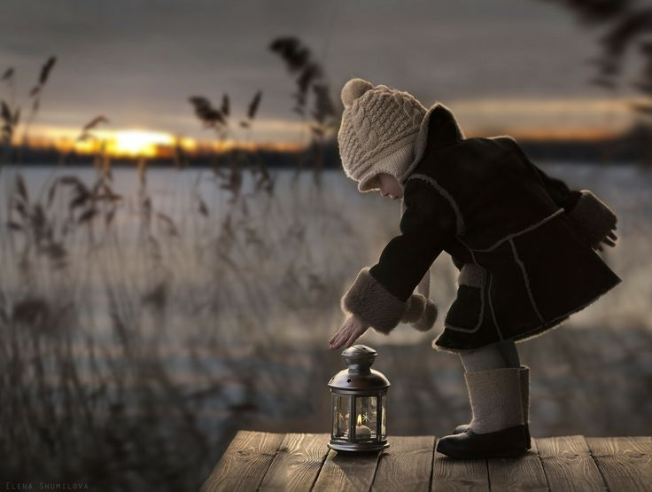 This child is lighting a path for someone. Light will keep someone from tripping and maybe falling.