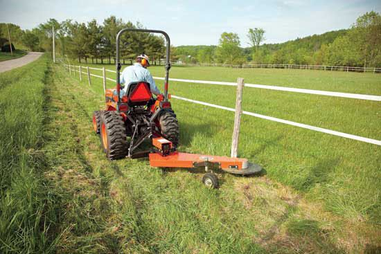 3 Point Hitch Trimmer Pulled By A Tractor A Fence Line