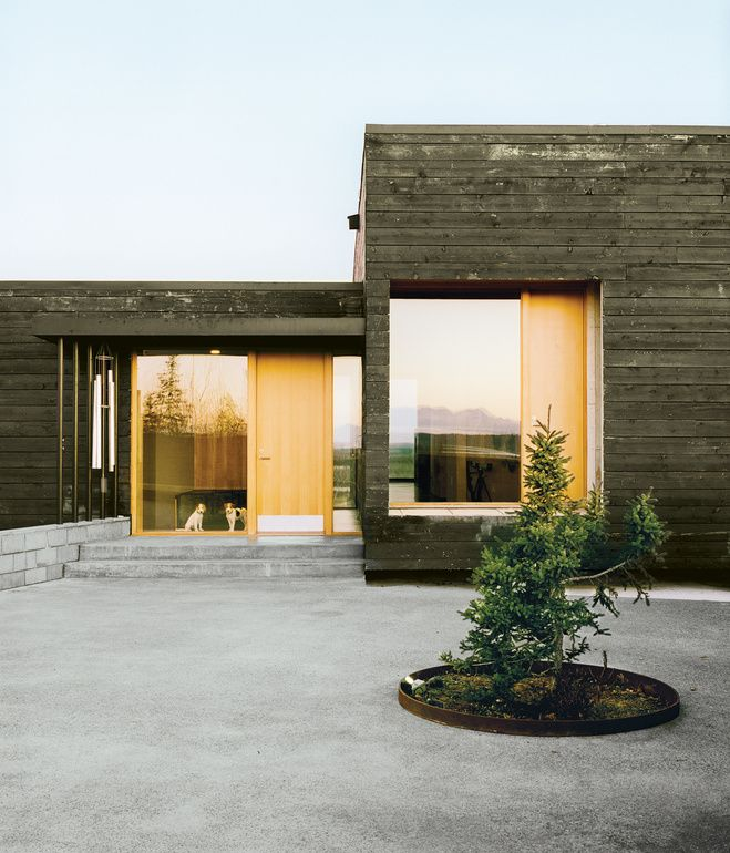 A series of charred modern boxes organized around views of the Alaskan landscape. Petra Sattler-Smith and Klaus Mayer.