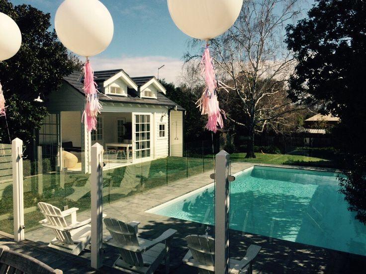 Giant white balloons. Pool party style, white pool house