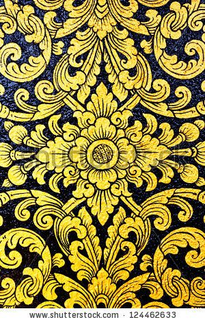 flower pattern in traditional Thai style art painting on window of the temple by Panna Studio, via Shutterstock