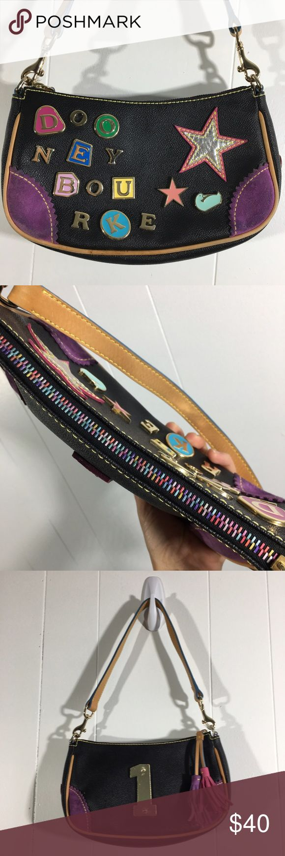 "Dooney and Bourke crescent zip top Lindsay Lohan 1 Sold as is please see photos❗️❗️❗️❗️Authentic original price $195. Rainbow zipper. A little discoloration on the inside and on Suede corners. 9.5"" by 6"" by 3"". Removable strap 21"" long. Strap drop 10"". One inside slide pocket was made for an early 2000s phone and one inside zipper pocket 4"" deep and 7"" wide. Although this purse is new with tags it definitely has some wear since it is maybe 15 years old. Dooney & Bourke Bags Shoulder Bags"