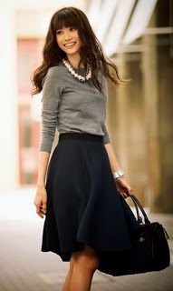 Perfect mix between Midi Skirt, and casual sweater, and pearls. Relaxed elegance