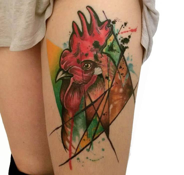 Refreshing colors, refreshing concept of an abstract rooster in an arm tattoo. The lines fragmenting the image of the rooster give a sense of perspective to the whole composition and depending on the focus where you place your eyes, you will admire a complete different side to this enigmatic image.