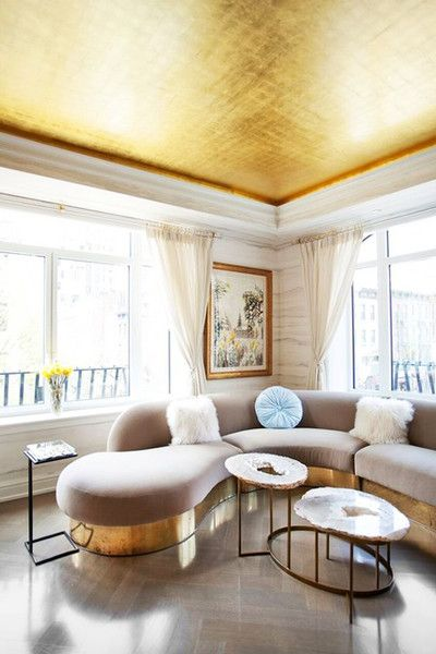 """If you want a glam look, there's little that screams """"glam"""" more than gold! We love that this space is so understated, that the furniture is all in light colors, and the only other gold in the space is mirrored in the base of the couch, which helps the space not to feel tacky or overwhelmed by the gold."""