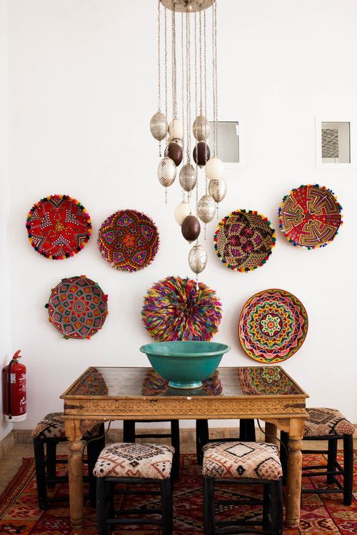 Amazing African dining room with beautiful multicolored baskets as wall art @pattonmelo; inspiration for crochet