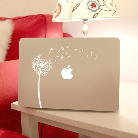 This vinyl design features a dandelion blowing in the wind. It is intended for use with a Apple Macbook laptop, but it can also be used for