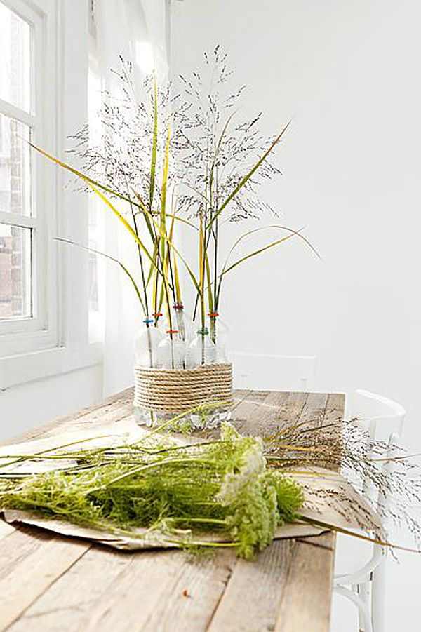 instant styling - vt wonen    bundle a few plastic bottles with some rope and put flowers in them