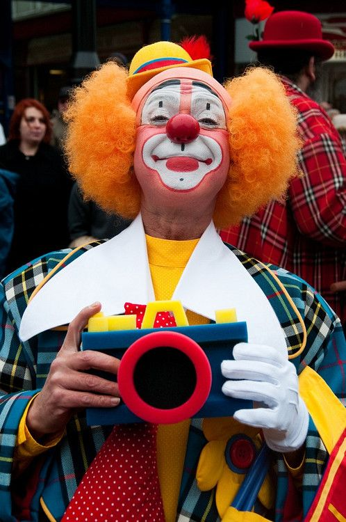 Clown with foam camera at the International Bognor Clown Festival in Bognor Regis, Sussex, England.