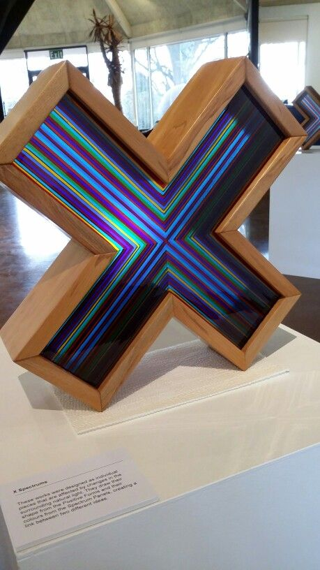 X Spectrum - fused glass, recycled native rimu timber.  Art by Hamish Mio