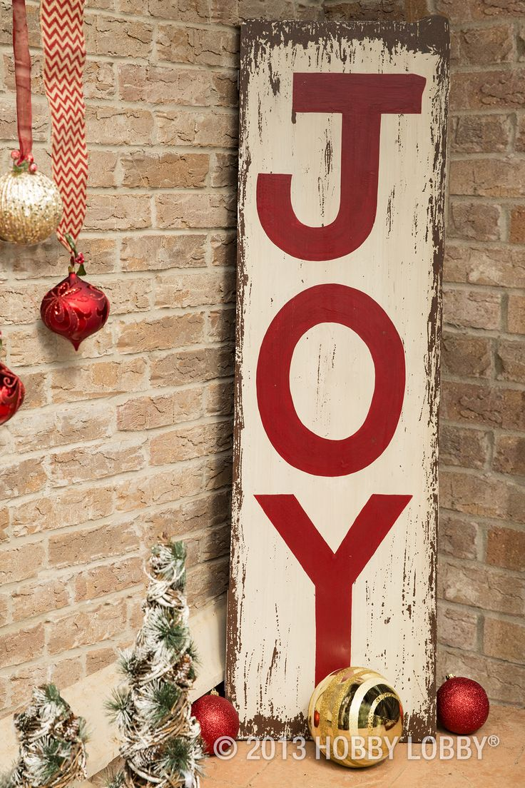 A Christmas wish on a charming painted sign is a lovely way to make holiday guests feel welcome the moment they're at your door.
