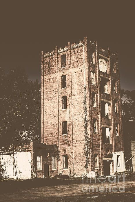 Urban destruction shown in an abandoned and ruined city building in washed out decay. Lincoln's Oakbank Brewery, Narrandera, NSW, Australia by Ryan Jorgensen