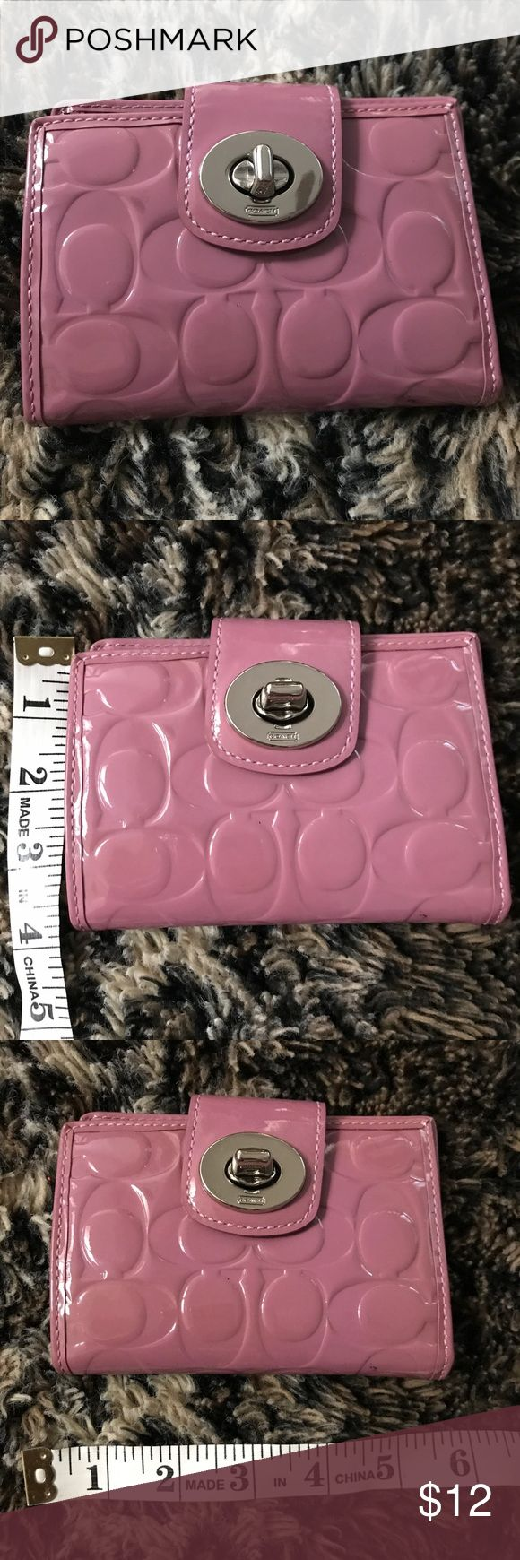 Coach bi fold wallet Patent light purple colored bi fold wallet from Coach. Leather inside. Slot for I.D. with multiple credit card slots. Zipped coin pouch on opposite side. Turn lock closure. Has minor signs of wear, otherwise clean inside. Coach Bags Wallets