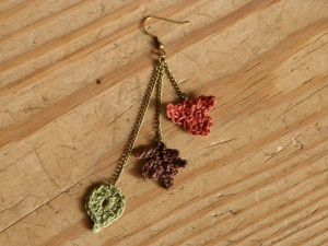 "Crochet Pattern: Autumn Leaf Earrings. The chains being alternating ""rings"" of black, purple and blue. Then the leaves being the orange, red and yellow. Idk... too much??"